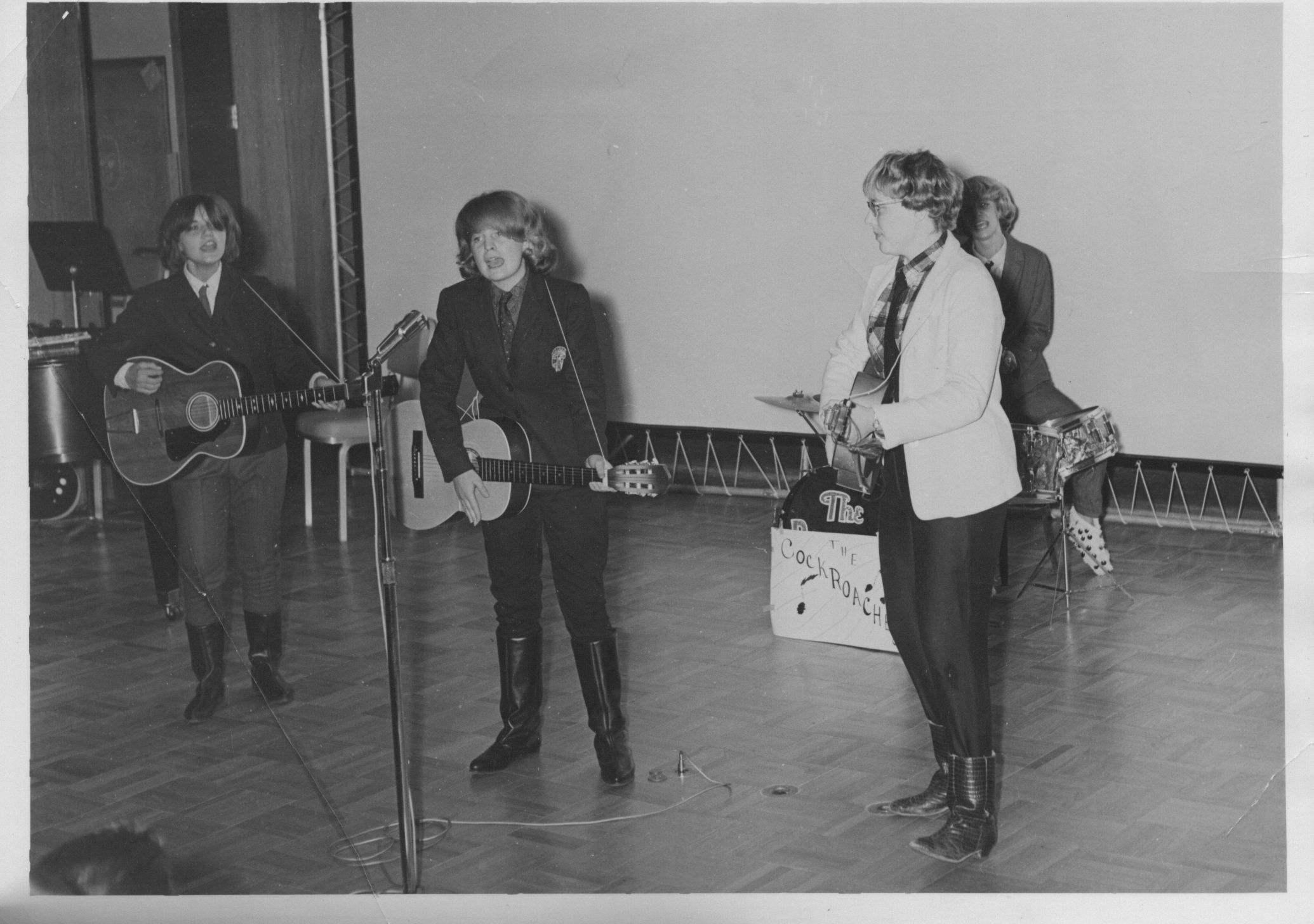 "Freshmen in September 1964 presented a variety show to an SRO crowd in Schomburg. These four girls performed as The Cockroaches, spoofing the then-top-of-the-charts Beatles, but using their own lyrics, such as ""They'll Flunk You,"" and ""Don't Bother Us."""